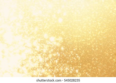 Golden round bokeh or glitter lights festive gold background. Christmas abstract template