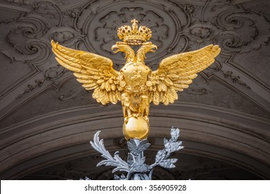 The golden Russian Imperial two-headed eagle from the top of the gates of the Winter Palace in St. Petersburg.