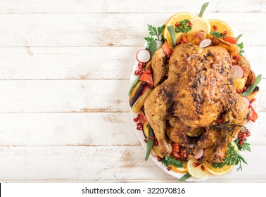 Golden rustic and stuffed roast turkey with vegetables,blank space