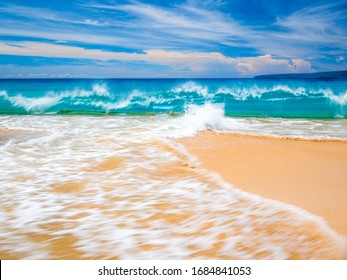 Golden sand of Big Beach in Maui Hawaii. Big Beach is also known by the names Makena Beach and Oneloa Beach, waves often big, and powerful.