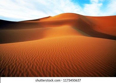 Golden sand dunes of the Morrocan desert with shadows, Morocco, Africa