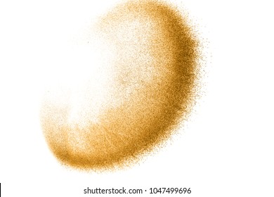 Golden sand explosion isolated on white background. Abstract sand cloud. Gold sand splash against on clear background. Sandy fly wave in the air.