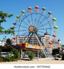 GOLDEN SANDS,BULGARIA - MAY29,2016:Ferris wheel with Admiral Hotel in background at Golden Sands resort. Golden Sands is a top destination on the coast of Black Sea located near the city of Varna.