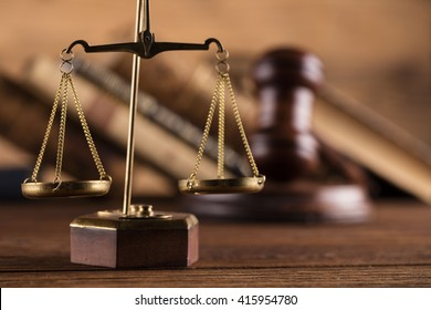 Golden scales of justice, gavel and books on brown background Law code, gavel and books.