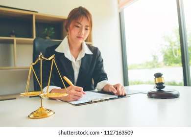 Golden scales of justice with Justice lawyers, Businesswoman in suit or lawyer, Advice and Legal services Concept.