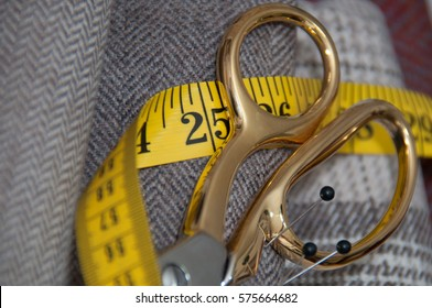 Golden scissors and tweed fabric