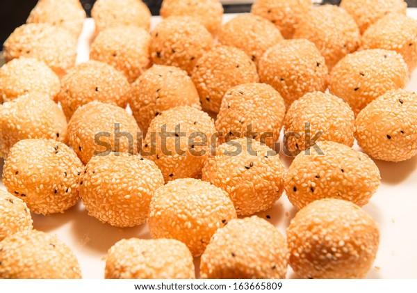 Golden Sesame Glutinous Rice Balls on white plate.