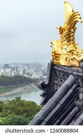 Golden Shachihoko and cityscape of Okayama city, Japan