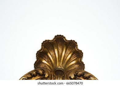 Golden shell sculpted on a mirror