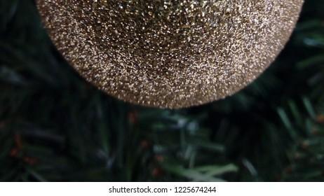 Golden shimmering christmas tree, globe decoration, close up.