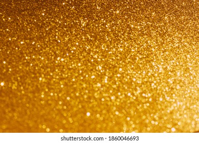 Golden shiny background. Defocused abstract background. Selective focus. Fashionable in 2021 the color of Set Sail Champagne.