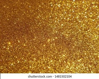 Golden shiny glitter texture background