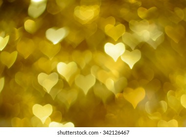 Golden shiny heart bokeh background