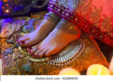 Golden Shiny Oriental Jewelry, Accessories: Female Hands with beautiful National Indian Jewellery, Eastern Fairy Tale, Wedding Luxury Fashion and Beauty. Traditional Sari clothes details. Color lenses