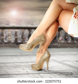 golden shoes and woman