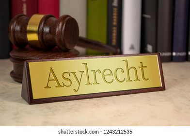 Golden sign with the german word for right of asylum - Asylrecht
