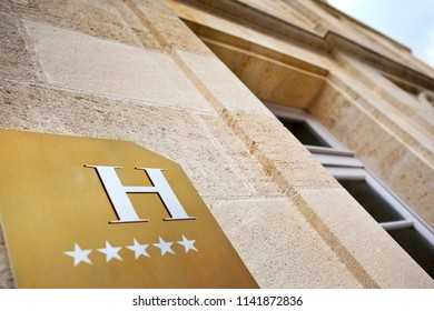 Golden sign on the facade of a luxurious hotel