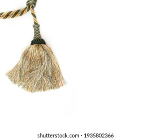 Golden silk tassel isolated on white background for creating graphic concepts
