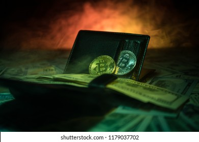 Golden and silver bitcoins and a lot of dollars in leather wallet. Bitcoin with dollar in purse. Profit from mining crypto currencies. Selective focus. Bussiness, commercial.