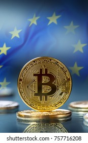 Golden and silver bitcoins - virtual cryptocurrency. Flag of european union in the background.