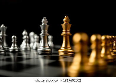 Golden and silver Chess king pieces Invite face to face and There are chess pieces in the background. Concept of competing, leadership and business vision for a win in business games