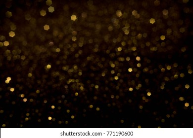 Golden and silver glitter backgound with bokeh abstract blur effect