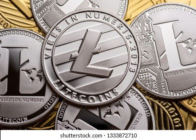 Golden and silver litecoin coins, close-up. Crypto currency concept.
