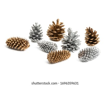 golden and silver pine cones isolated on white background