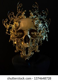 golden skull made with 3d printer and pieces by hand. Gothic piece of decoration for halloween or horror scenes
