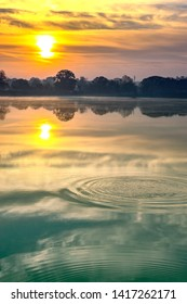 Golden  sky with clouds and morning  Sun reflected  in lake waters of  Dalpat Sagar  at Jagdalpur, Bastar, Chhattisgarh, India., Asia