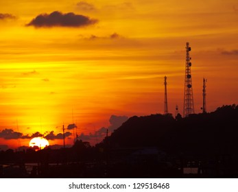 Golden sky with telecommunication tower on top of mountain