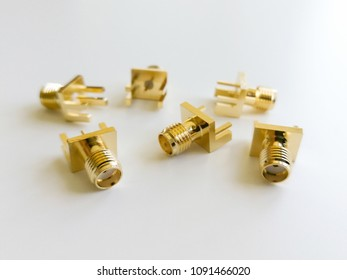 Golden SMA microwave signals connector isolated on the white background