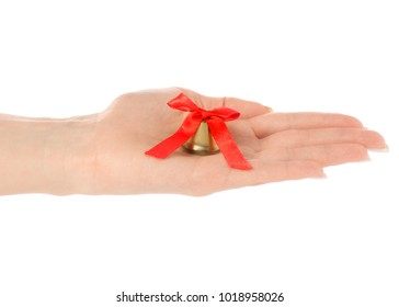 Golden small bell in hand on white background isolation