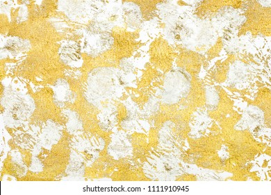 golden smears on a white background sprinkled with gold sparkles