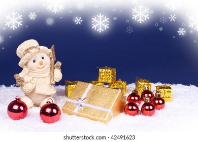 golden snowman figure and red , gold xmas balls