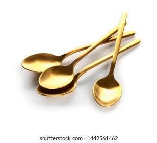Golden spoons on white background