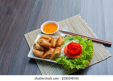 Golden spring rolls and the chopsticks