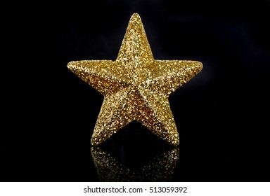 Golden star on a black background
