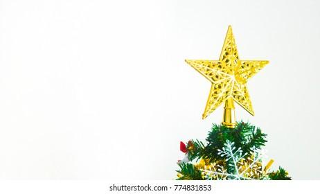 golden star on christmas tree in white background