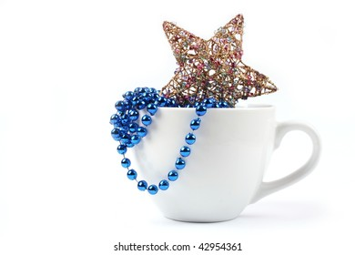 Golden star and pearls in beautiful white cup