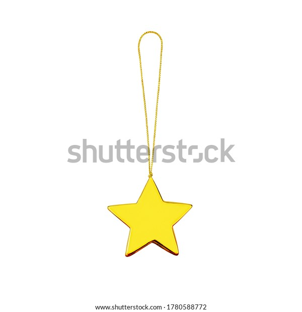 Golden star white background isolated closeup, Сhristmas tree decoration, shiny gold metal star shape bauble, traditional new year holiday decor design element decorative xmas yellow glass hanging toy