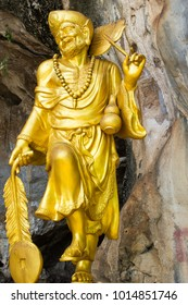 The golden statue of Chinese Buddha monk in standing position. Ji-Gong (Chan Master Daoji, Chan Buddhist monk). Concept of Buddhism, Art, Asia culture, Buddhist temple and  Maha Nikaya sect.