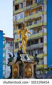 Golden statue in front of old block of flats, Batumi, Georgia