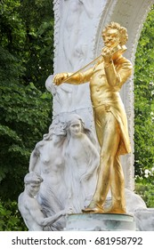 The golden statue of the great musician Johann Strauss in the city park, Vienna, Austria (built in 1921)