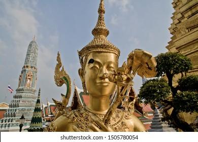 Golden statue of Kinnari inside the Grand Palace