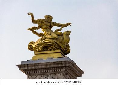 Golden statue on a bridge in Tianjin crossing the Hai river, Tianjin, China