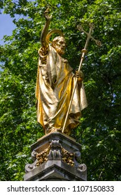A golden statue of Saint Paul on St. Pauls Cross located in the churchyard of St. Pauls Cathedral in London, UK.