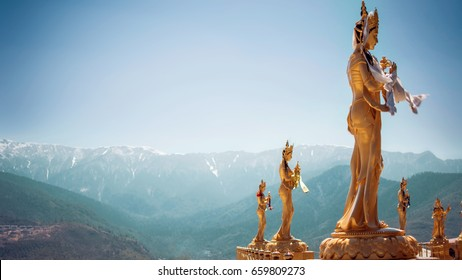 Golden statues of Buddhist deity in Thimphu , Bhutan