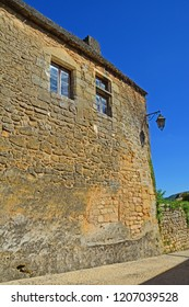 Golden stone walls in the Perigord region of France