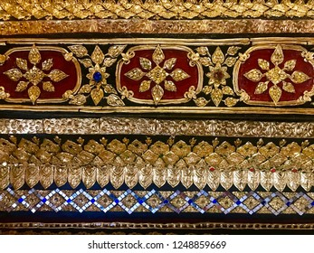 Golden stucco in Thai temple. It is very common to see this traditional art in Thai temple when the stucco of cement will be cover neatly by real gold leaf reflecting Thai belief of luck and glory.